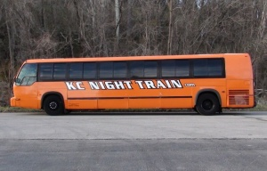 Driver's side of Orange Party Bus
