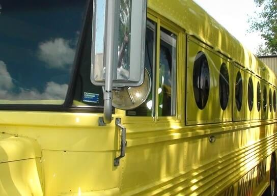 Mellow Yellow Party Bus exterior as seen from the front on the driver's side
