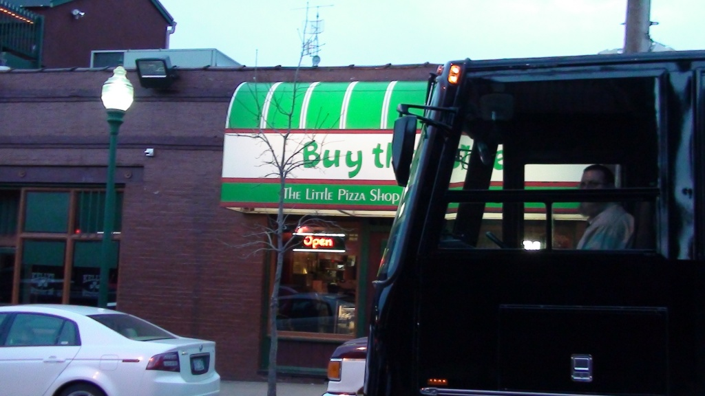 Black VIP Party Bus in front of Joe's Pizza in Westport