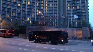 Black VIP Party Bus parked in front of hotel