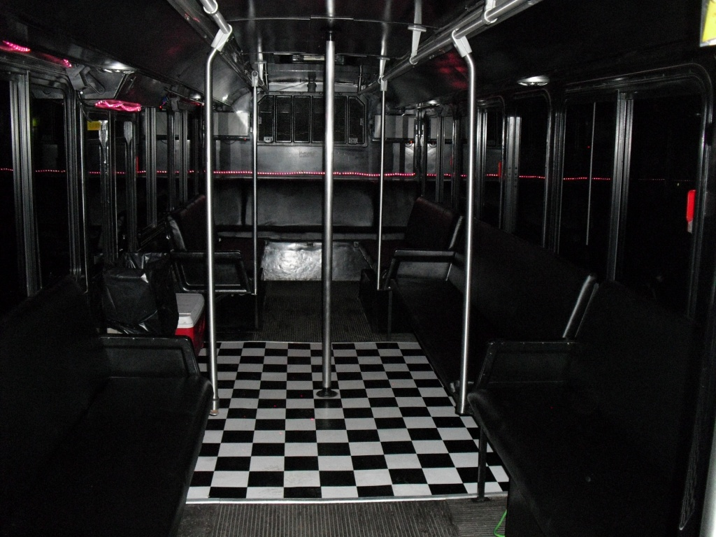 Inside the Green Party Bus looking towards the back (party lights off).