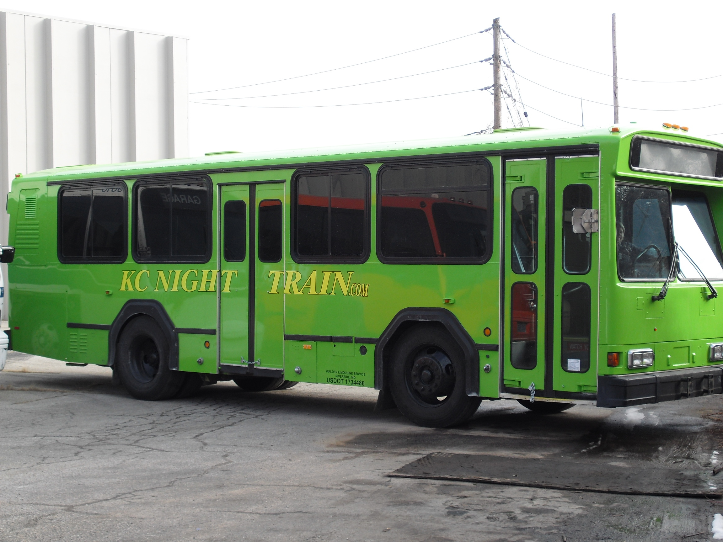 Green Party Bus as seen from the front on the passenger's side