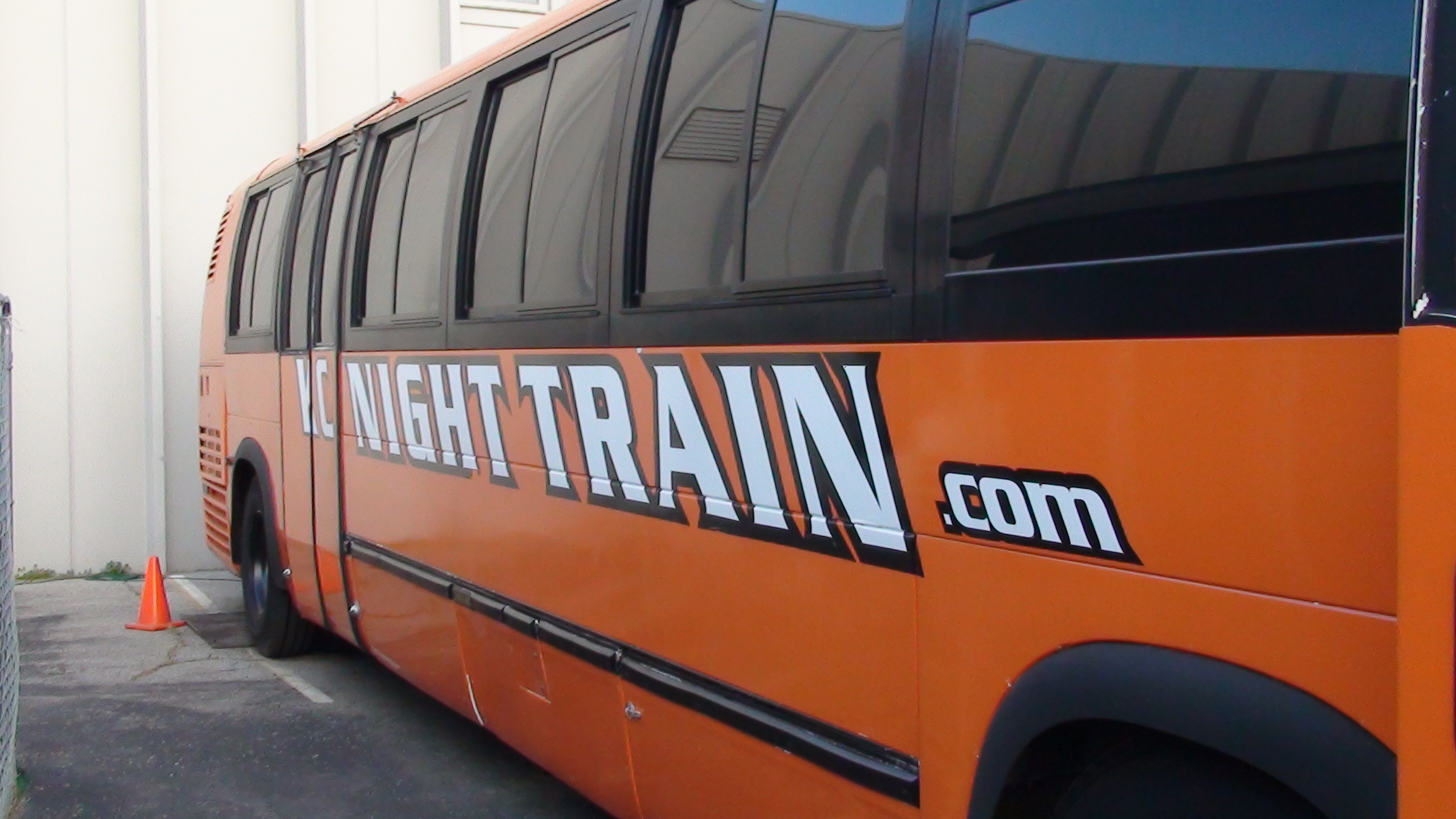 kansas-city-night-train-orange-party-bus-side1