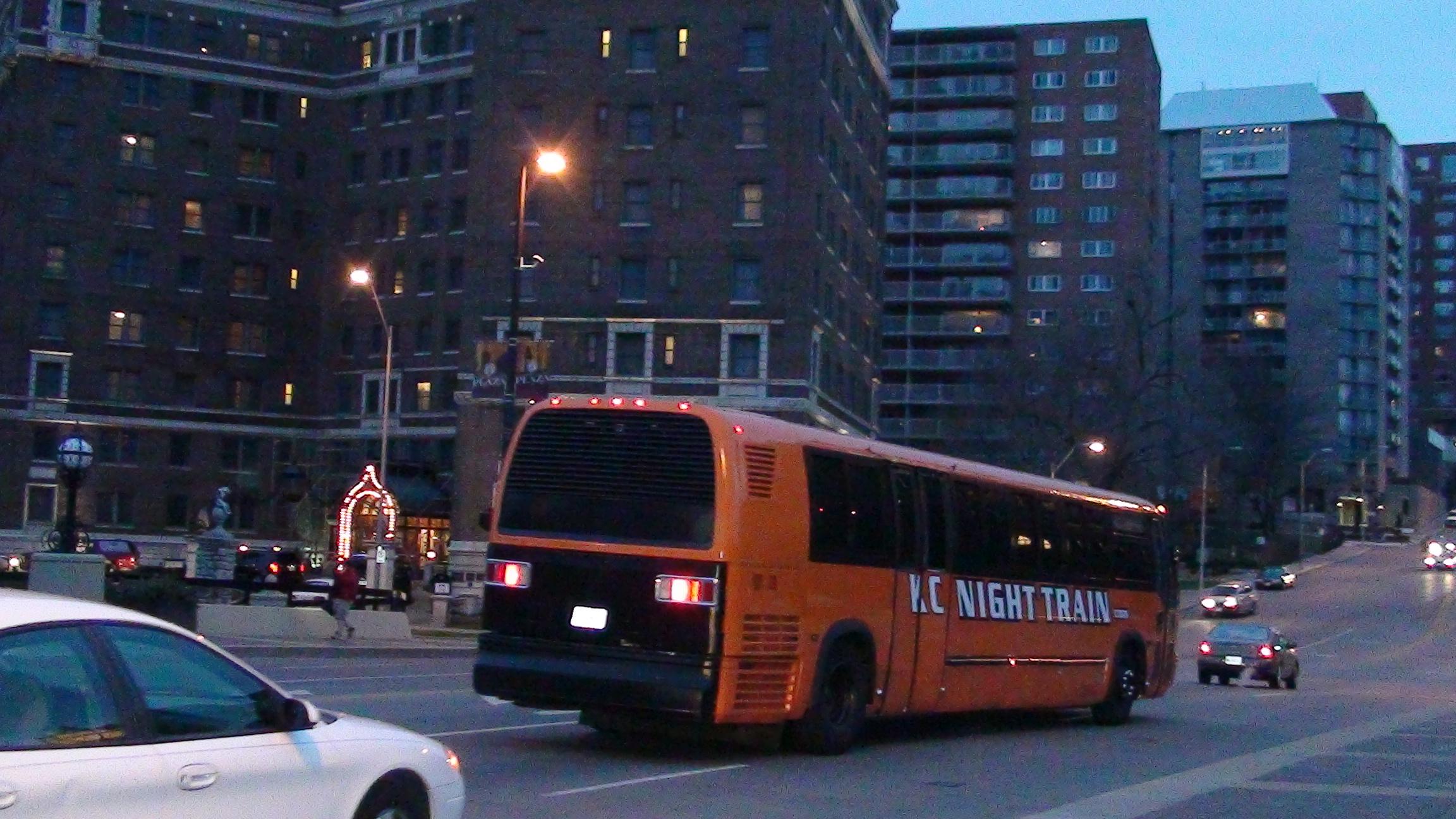 kansas-city-night-train-orange-party-bus-country-club-plaza