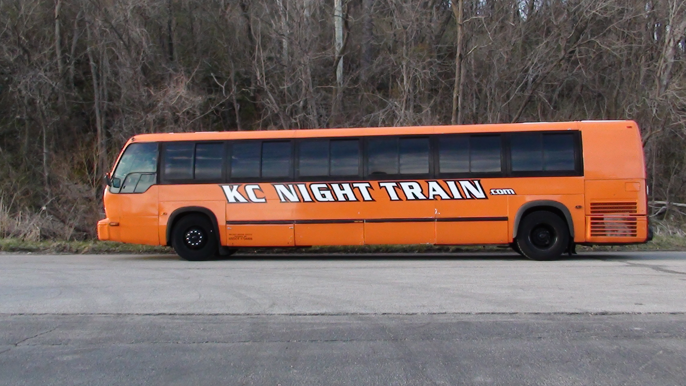 kansas-city-night-train-orange-party-bus