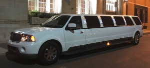 View from driver's side of White SUV Limousine